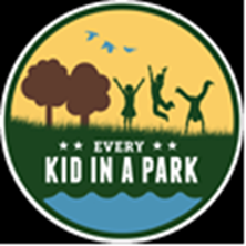 Logo picture shows silouettes of kids playing in a park with trees, water, grass, sky and birds